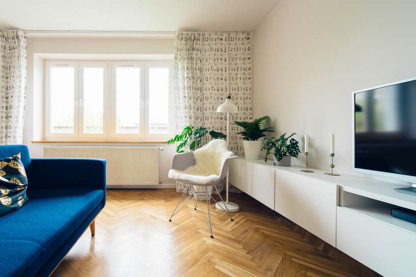 living room with central heating and wooden floor